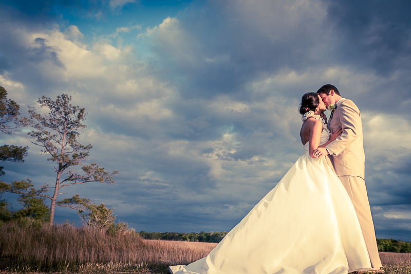 dramatic sky with bride and groom