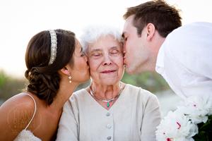bride and groom kiss grandma