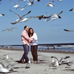 Couple at the beach with seagulls
