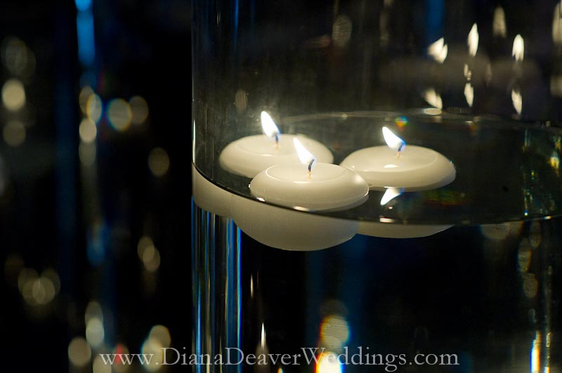 glass flowers and candles wedding decorations captured by wedding