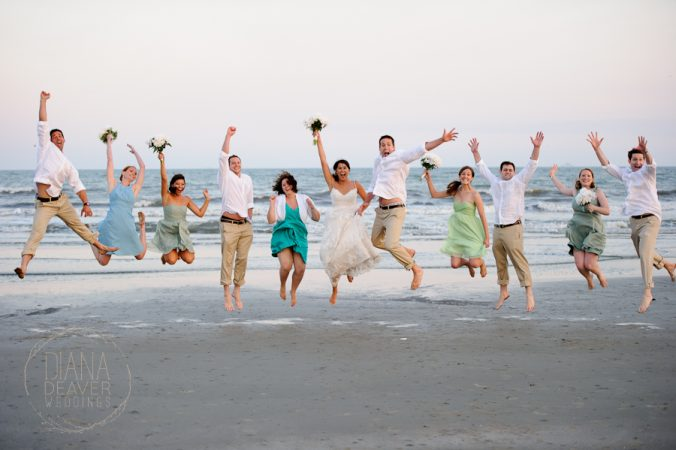 wedding party jumping on the beach kiawah