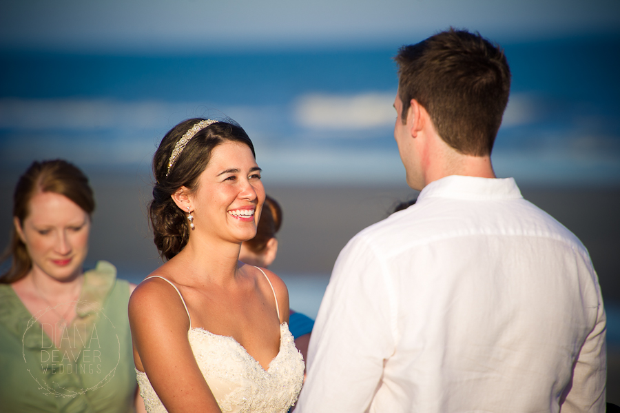 bride smiles at groom kiawah island sc sandcastle