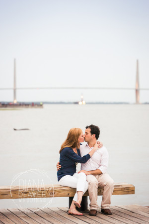 Engagament Session Downtown Charleston with ravenel bridge and dolphin in the background