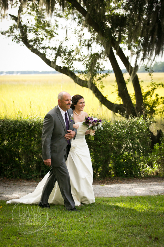bride walking down the isle with her father at ion creek club