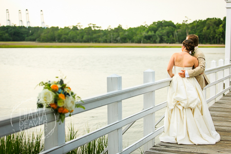 bride and groom wedding dock at the creek club at ion at dusk