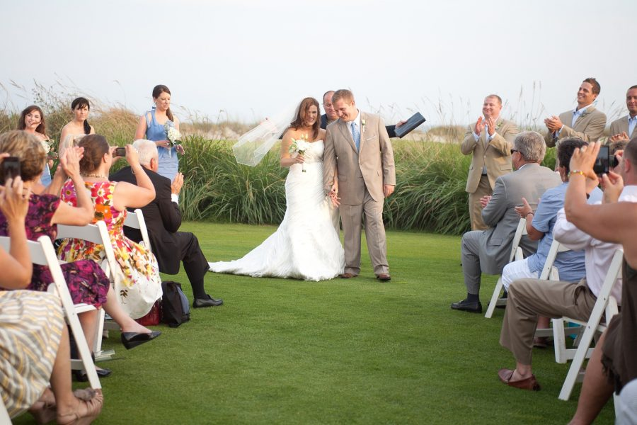 bride and groom golf course lawn  ceremony kiawah island sc