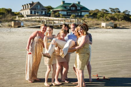 bridesmaid hold the groom kiawah