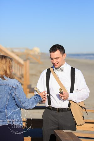 beach ushers wth canvas bags and paper scroll program